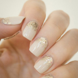 Beige nail polish with sparkles photo