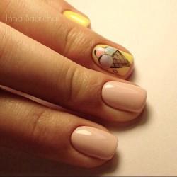 Manicure by yellow dress photo