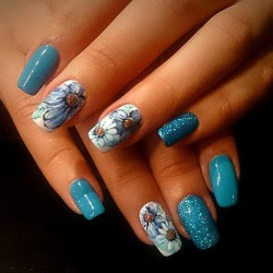 Nails with blue flowers photo