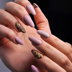 Metallic gold nail polish photo