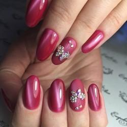 Nails under raspberry dress photo
