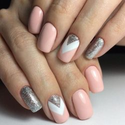 Pink nail polish with sparkles photo