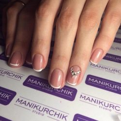 Beige nails with rhinestones photo