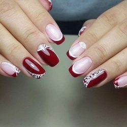 Maroon nails with a picture photo