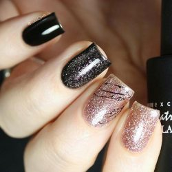 Metallic gold nail polish photo