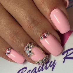Pink nails with stones photo