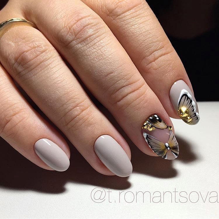 Delicate nails with a butterfly