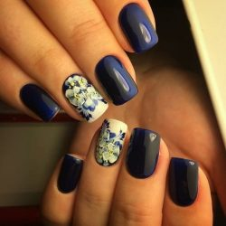 Nails by a dark blue dress photo
