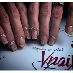 Nails with gold sequins photo