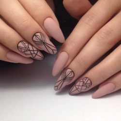 Beige nails with black pattern photo