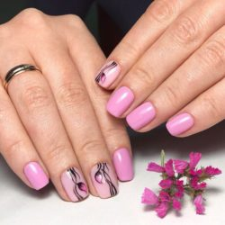 Manicure on a pink background photo