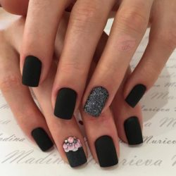 Black nails with a picture photo