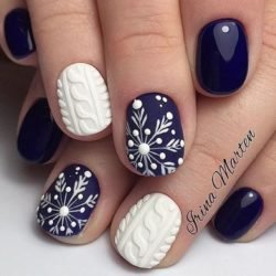 Snowflakes on nails photo
