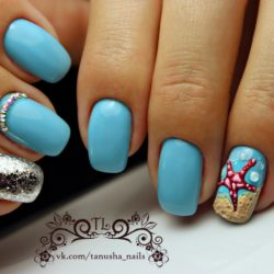 Blue nails with a picture photo