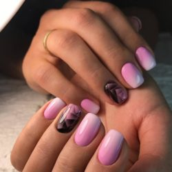 Pink nails with a black pattern photo