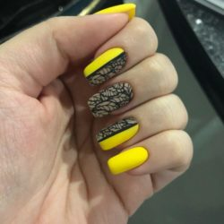 Yellow nails with black pattern photo